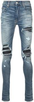 Amiri distressed skinny jeans with biker panel inserts