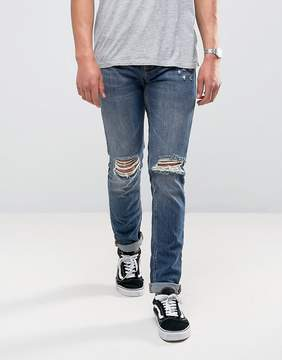 Pull&Bear Slim Jeans With Heavy Knee Rips In Dark Wash Blue