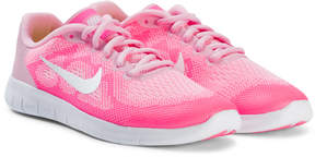Nike Pale Pink and White Free Running Shoes