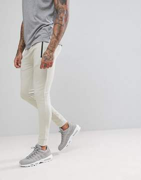 Asos Super Skinny Joggers With Zip Pockets In Beige