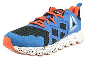 Reebok Exocage Round Toe Synthetic Running Shoe.