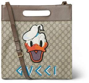 Gucci + Disney Leather-Trimmed Appliquéd Monogrammed Coated-Canvas Tote Bag
