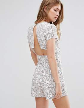 Goldie Reily V Neck Romper With Open Back Detail In Feather Print