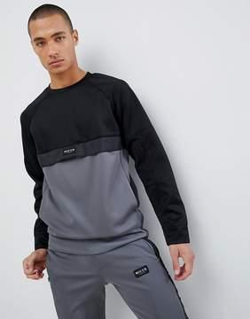 Nicce London track sweatshirt in black with gray panel