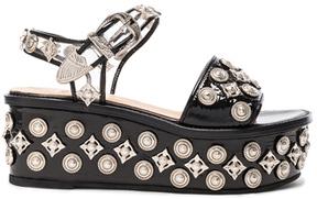 Toga Pulla Patent Leather Platform Sandals in Black.