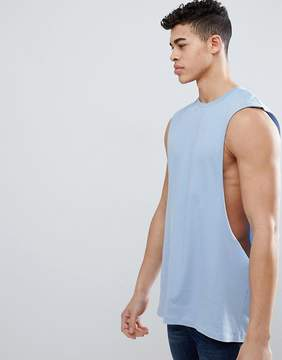 Asos DESIGN longline tank with extreme dropped armhole in blue