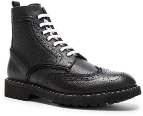Givenchy Leather Wingtip Boots in Black.