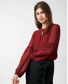 Express cut-out long sleeve blouse