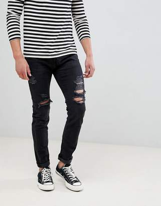 Abercrombie & Fitch skinny fit destroyed jeans in black