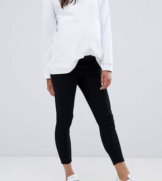 Asos DESIGN Maternity Petite Ridley high waisted skinny jeans in clean black with under the bump waistband