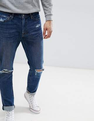 Abercrombie & Fitch Stretch Super Slim Distressed Jeans in Mid Wash