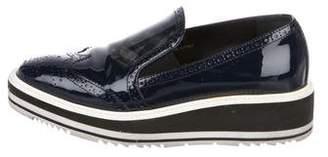 Prada Wing-Tip Platform Loafers