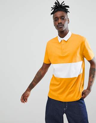 Asos Design DESIGN rugby polo shirt with contrast panel in yellow
