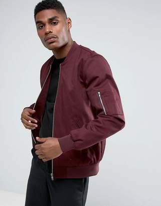 Asos DESIGN bomber jacket with sleeve zip in burgundy