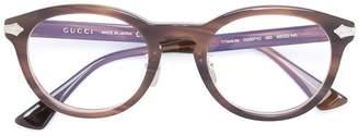 Gucci line detailing glasses