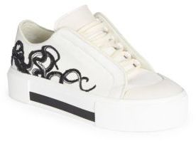 Alexander McQueen Embroidered Canvas & Leather Low-Top Sneakers $695 thestylecure.com