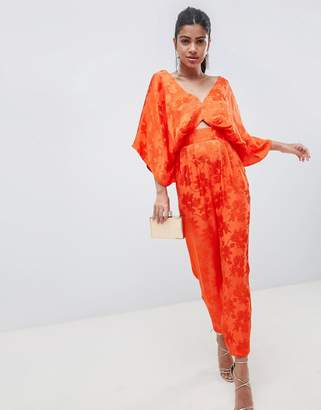 Asos DESIGN jumpsuit with kimono sleeve and cut out detail in jacquard