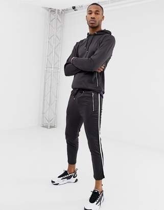 Asos DESIGN Retro Tracksuit Hoodie/ Skinny Joggers In Black With Side Stripe Panel