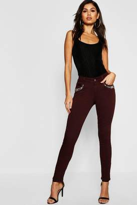 boohoo Mid Rise Embellished Front Skinny Jeans