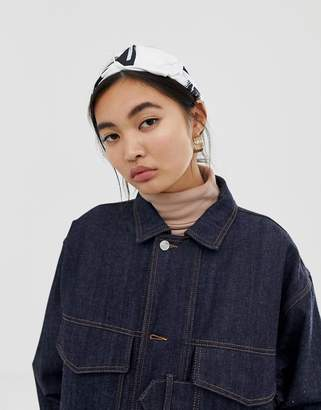 Asos Design DESIGN knot front headband in abstract print