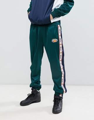 Ellesse Prezza logo taping popper joggers in green