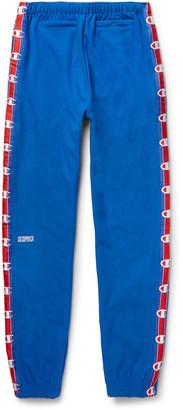 Vetements + Champion Slim-Fit Loopback Cotton-Blend Jersey Sweatpants $760 thestylecure.com