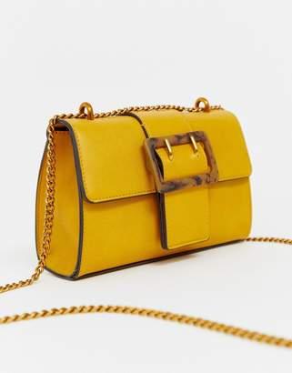 Asos Design DESIGN shoulder bag with tort buckle mustard