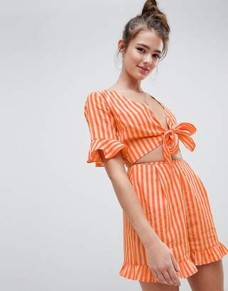 Asos DESIGN romper with cut out and tie detail in linen in stripe