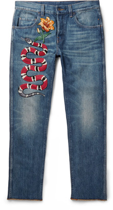Slim-Fit Embroidered Stonewashed Denim Jeans $1,090 thestylecure.com