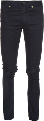 SAINT LAURENT Distressed skinny jeans $750 thestylecure.com