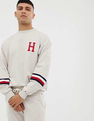 crew neck sweatshirt with icon sleeve strip and H badge in oatmeal