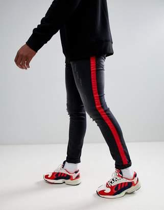 Criminal Damage skinny jeans in black with side stripe