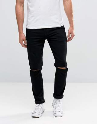 ASOS Skinny Jeans With Knee Rips In Black $43 thestylecure.com