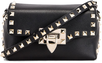 Valentino Rockstud Mini Crossbody Bag in Nero | FWRD