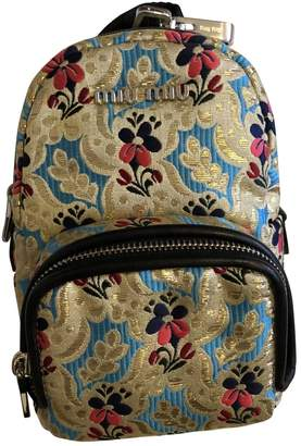 Miu Miu Gold Cloth Backpacks
