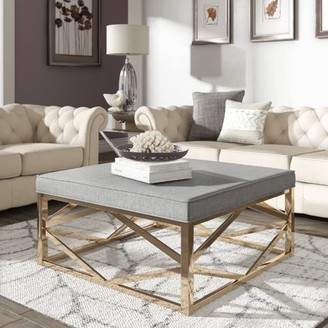 Weston Home Libby Smooth Top Cushion Ottoman Coffee Table with Champagne Gold Geometric Base, Multiple Colors