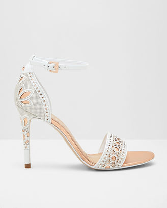 Laser cut strappy heeled sandals $295 thestylecure.com