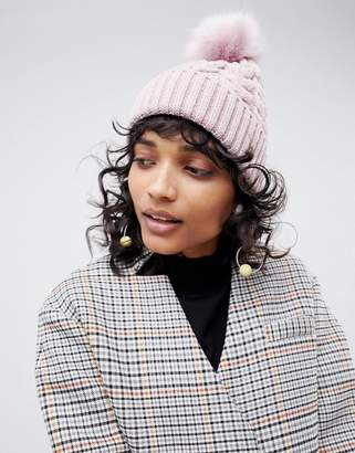 Asos DESIGN cable faux fur pom beanie In recycled polyester