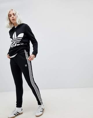 adidas adicolor Three Stripe Regular Fit Cuffed Track Pants In Black