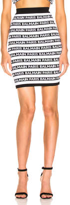 Balmain Logo Print Striped Pencil Skirt in Black & White | FWRD