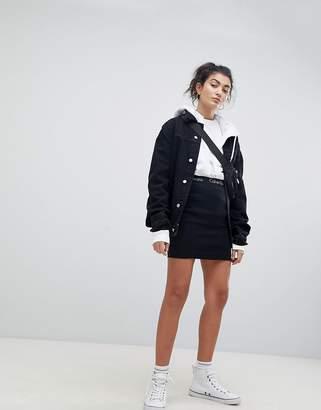 Calvin Klein Jeans Skin Tight Mini Skirt with Logo Band