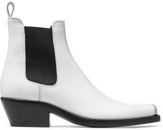 dbf5fd717fab Calvin Klein Claire Metal-trimmed Glossed-leather Ankle Boots - White