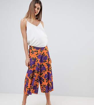 029ee747ff3af Asos DESIGN Maternity low rise bump band wide leg culottes with flowing hem  in orange floral