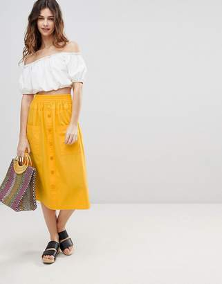 Asos DESIGN cotton midi skirt with button front