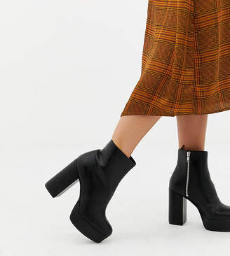 14266a70c5e Monki zip heeled platform boot in black