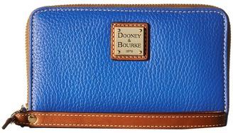 Dooney & Bourke Pebble Zip Around Credit Card Phone Wristlet $118 thestylecure.com