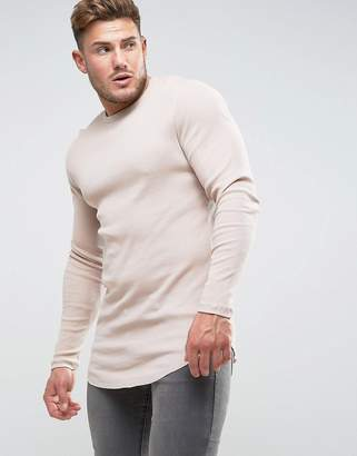 Asos DESIGN super longline muscle long sleeve rib t-shirt with curved hem in pink