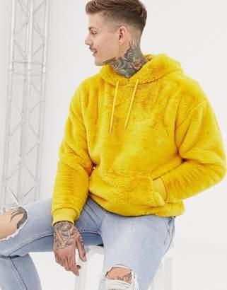 Asos DESIGN oversized faux fur hoodie in yellow
