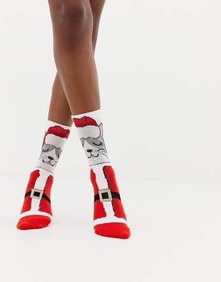 Asos DESIGN Holidays cat in santa outfit sock