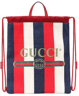 Gucci Striped drawstring backpack